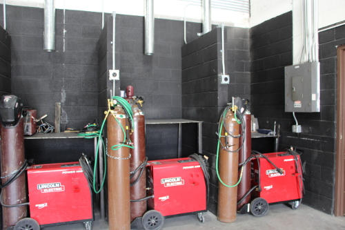 Three welding stations, ready for use.