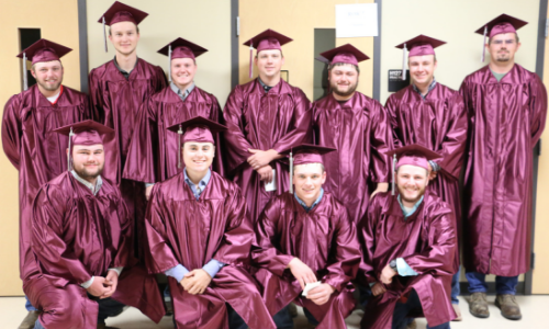 picture of a group of graduates posing for the camera