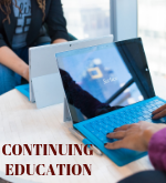 "two students sitting in front of computer with ""continuing education"" written in the corner"