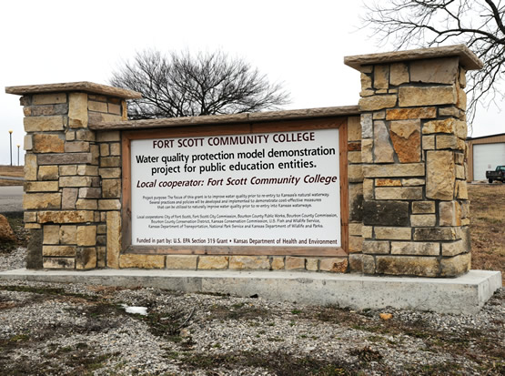 A stone sign for FSCC's water quality protection model demonstration project for public educations entities.