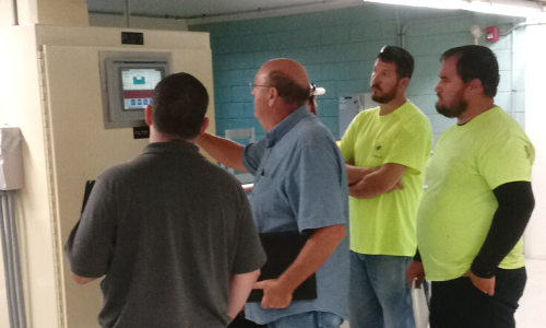picture of three students and an instructor learning about water technologies