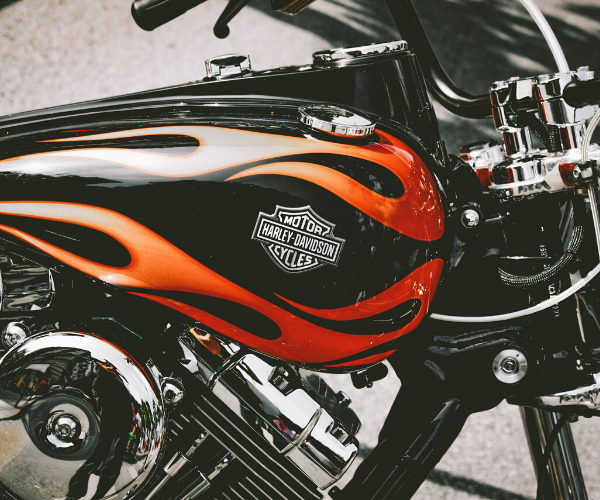 Harley-Davidson motorcycle with the logo on the side with flames around it