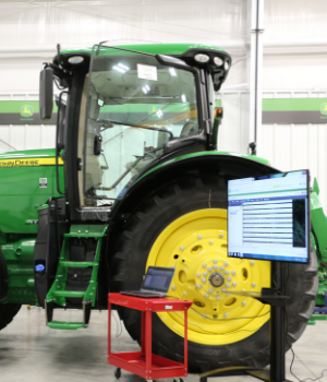 picture of a John Deere tractor hooked up to a diagnostics system
