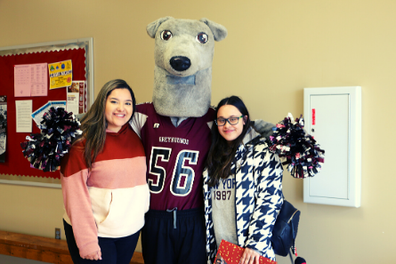 two girls posing with FSCC mascot
