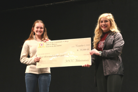 two ladies holding a FSCC check for 4,000 dollars
