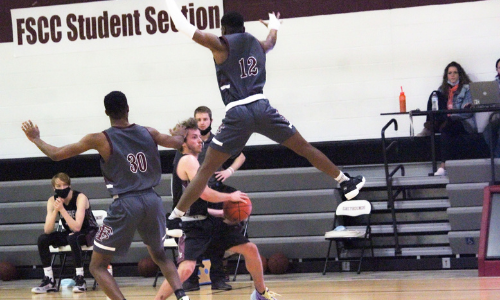 picture of a FSCC men's basketball player jumping to get the ball