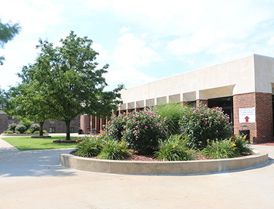 The FSCC Administration building's front entrance on a clear sunny day.