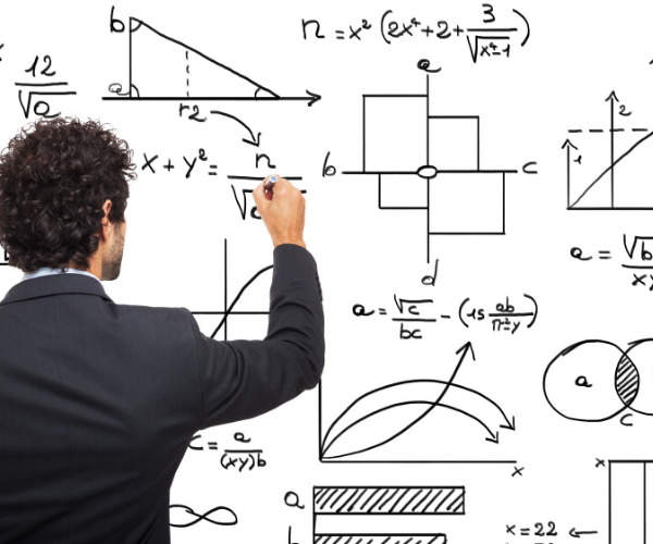 a man solving different difficult math problems on a white board
