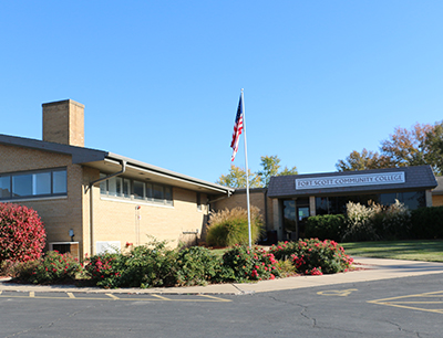 The Miami County Campus building's front entrance on a clear sunny day.