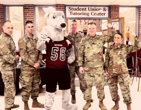 group shot of the national guard members and FSCC Gizmo