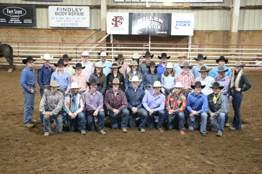 group picture of the rodeo team in the arena