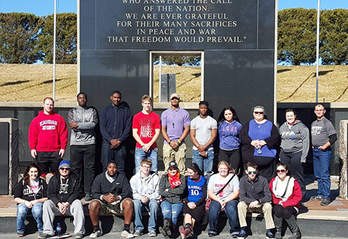 TRIO students gathered together at the Pittsburg State University's Veterans Memorial to honor our veterans.