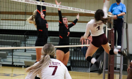 action picture of a fscc volleyball game, girl jumping at the net