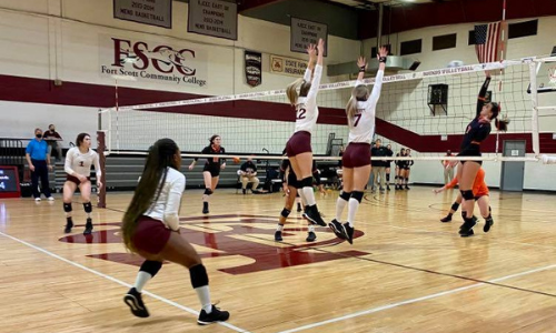action picture of a fscc volleyball game, two girls blocking a shot