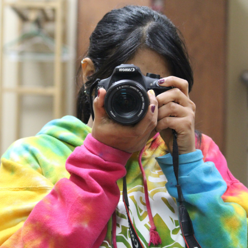 picture of a student holding a camera