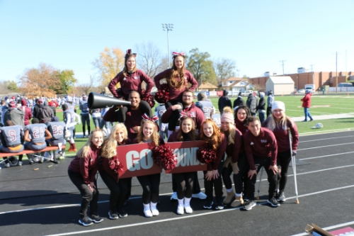spirit squad posing as a group at the homecoming football game