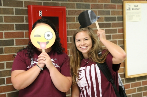 two female students posing with funny signs at welcome week