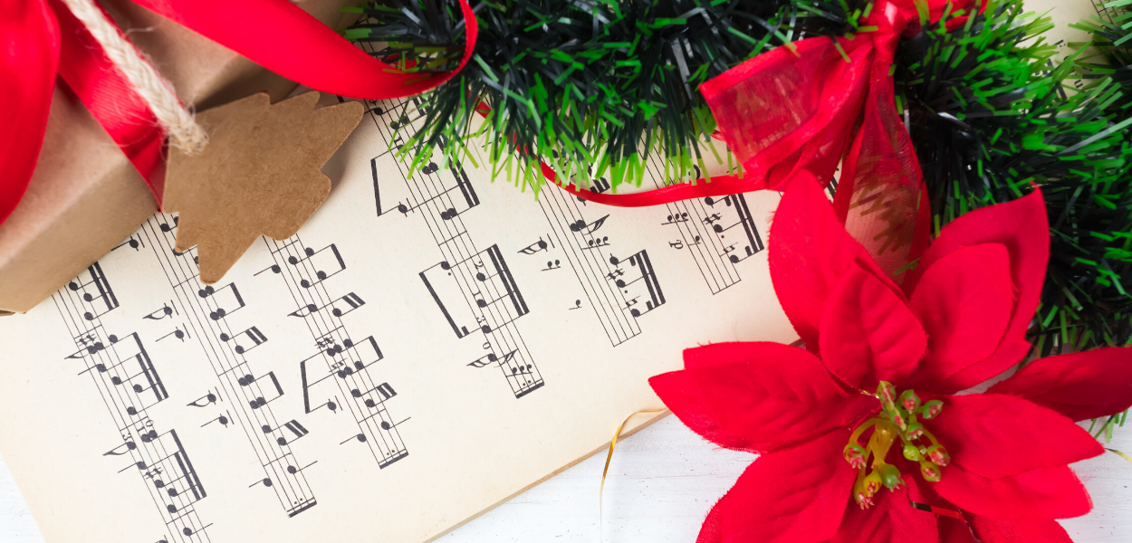 picture of sheet music with poinsettias around it