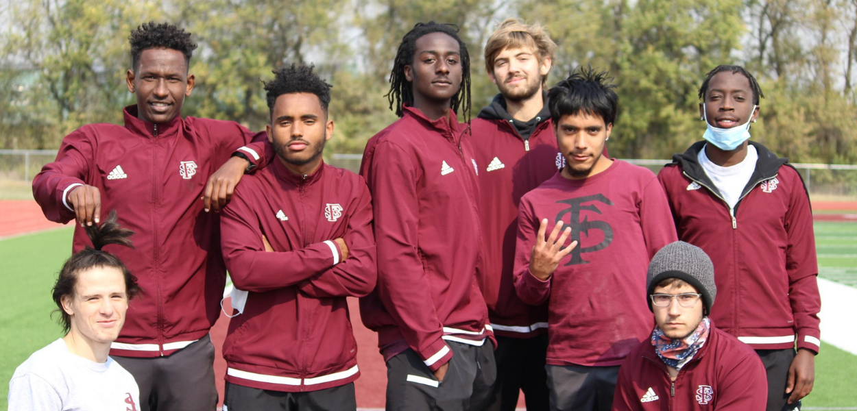 group picture of the men's cross country team