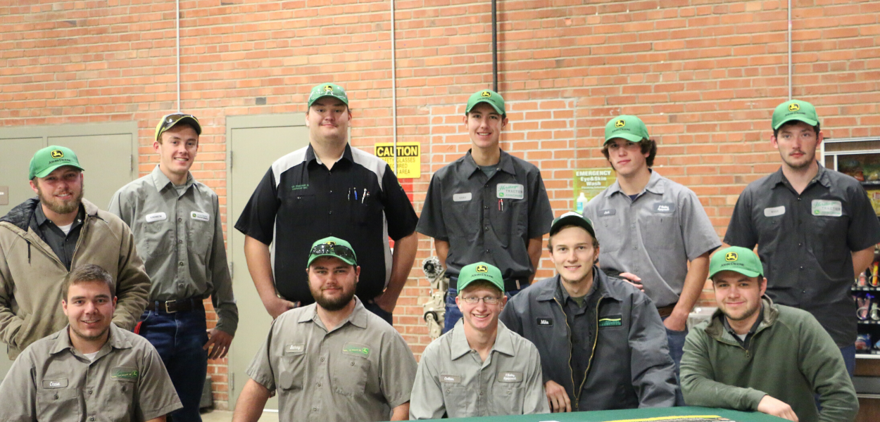 group picture of John Deere students posing for the camera