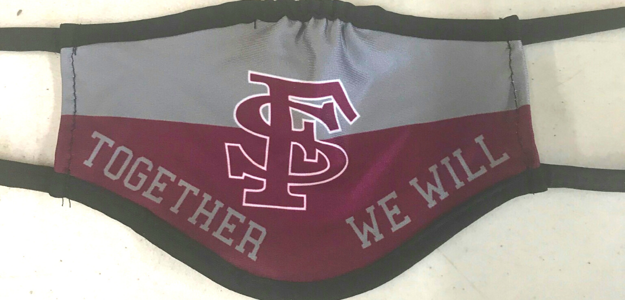 "picture of a maroon and grey face mask with the FS logo in the middle and ""Together we will"" written at the bottom"