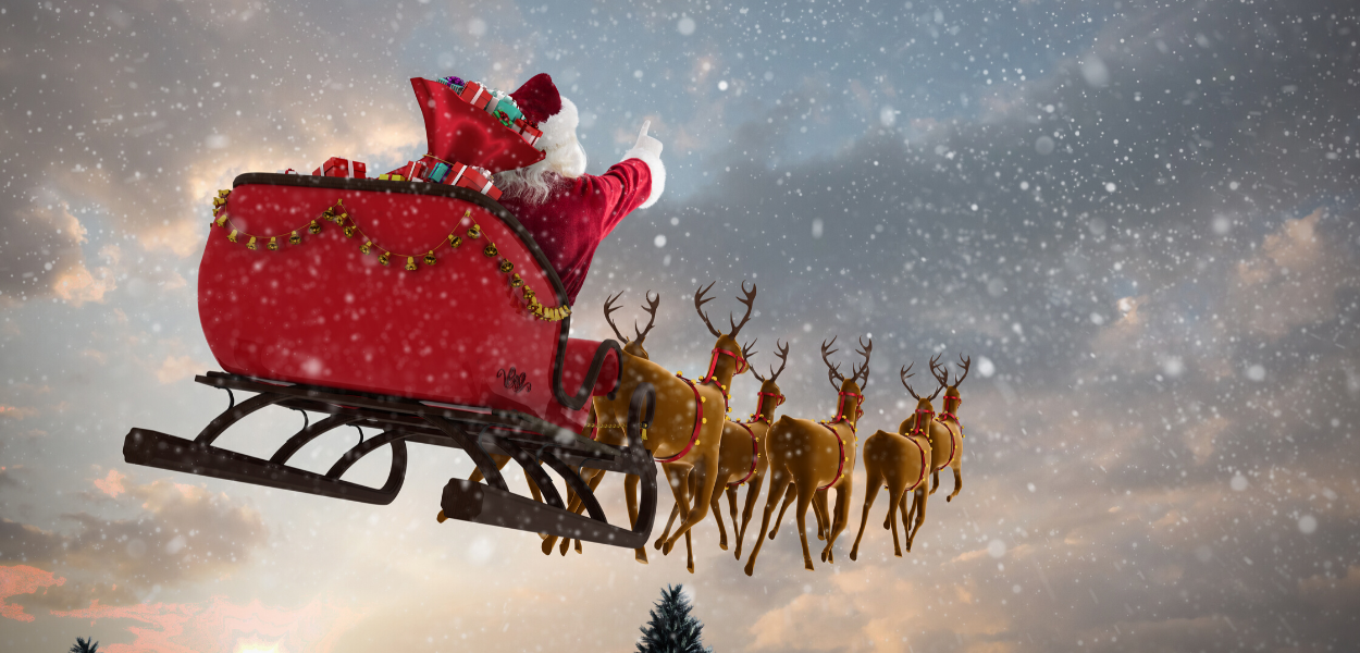 picture of santa flying with his reindeer