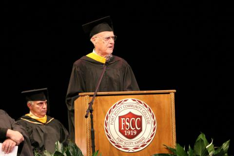 Ken Lyon speaking at graduation.