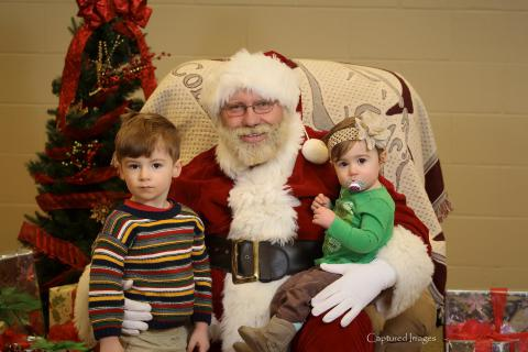 Beautiful children with Old Saint Nick.