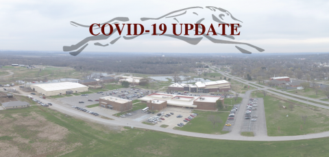 "picture of FSCC campus from a drone with a transparent running greyhound at the top with ""COVID-19 UPDATE"" written on top"