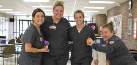 four nursing students posing for a picture in Bailey Hall