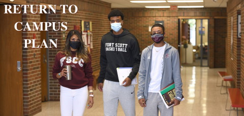 """three students standing together with masks on in bailey hall with """"return to campus plan"""" written in white in the top left corner"""
