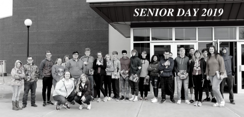 "group picture of students in front of the Ellis Fine Arts Center with ""Senior Day 2019"" written above them"