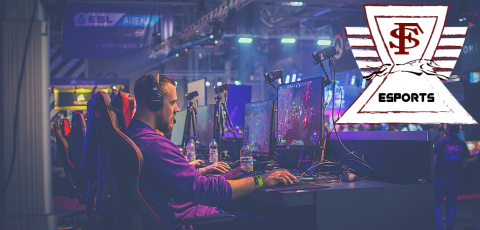 picture of a man playing a computer game and the F S logo in the right top corner