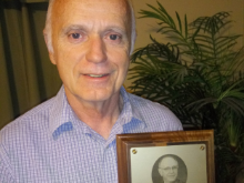 picture of Joe Cribbs holding the Jim Current Award